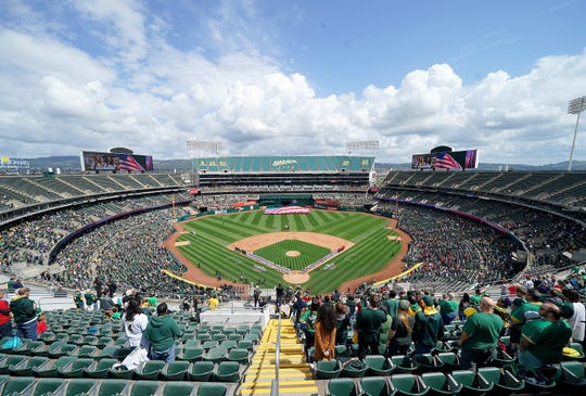 An overview of the Coliseum while the Los Angeles Angels of Anaheim and Oakland Athletics stand for the National Anthem on Opening Day of Major League Baseball at Oakland-Alameda County Coliseum on March 28, 2019 in Oakland