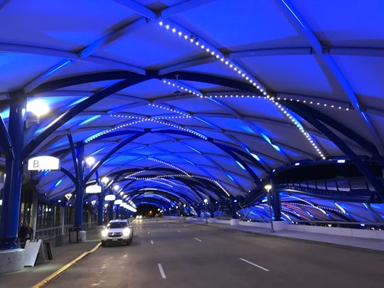 """The canopy at Rochester's airport will be bathed in blue lights throughout the hospitalization of police Officer Dennison """"Denny"""" Wright."""