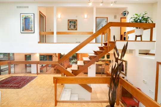 Multiple levels accentuate the open space in this mid-century modern house in Pittsford, designed by Rochester Architect James Johnson.