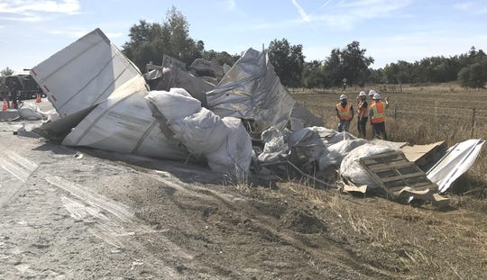 Wreckage sits on the side of southbound Interstate 5 from a big-rig crash into construction vehicles between Redding and Anderson on Tuesday, Oct. 8, 2019.