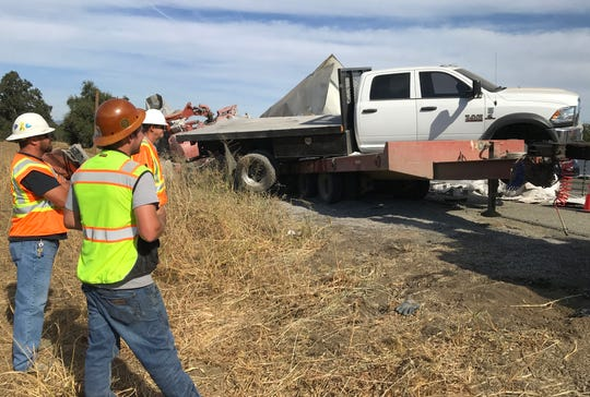 A flatbed involved in a big-rig collision on Interstate 5 between Redding and Anderson is hauled away by a tow truck on Tuesday, Oct. 9, 2019.