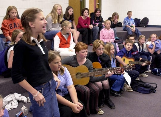 Lauren Macey, 13, rehearses her vocal part with the Stayton Middle School folk ensemble in 2002 in preparation for its performance in the American Roots Music Festival.