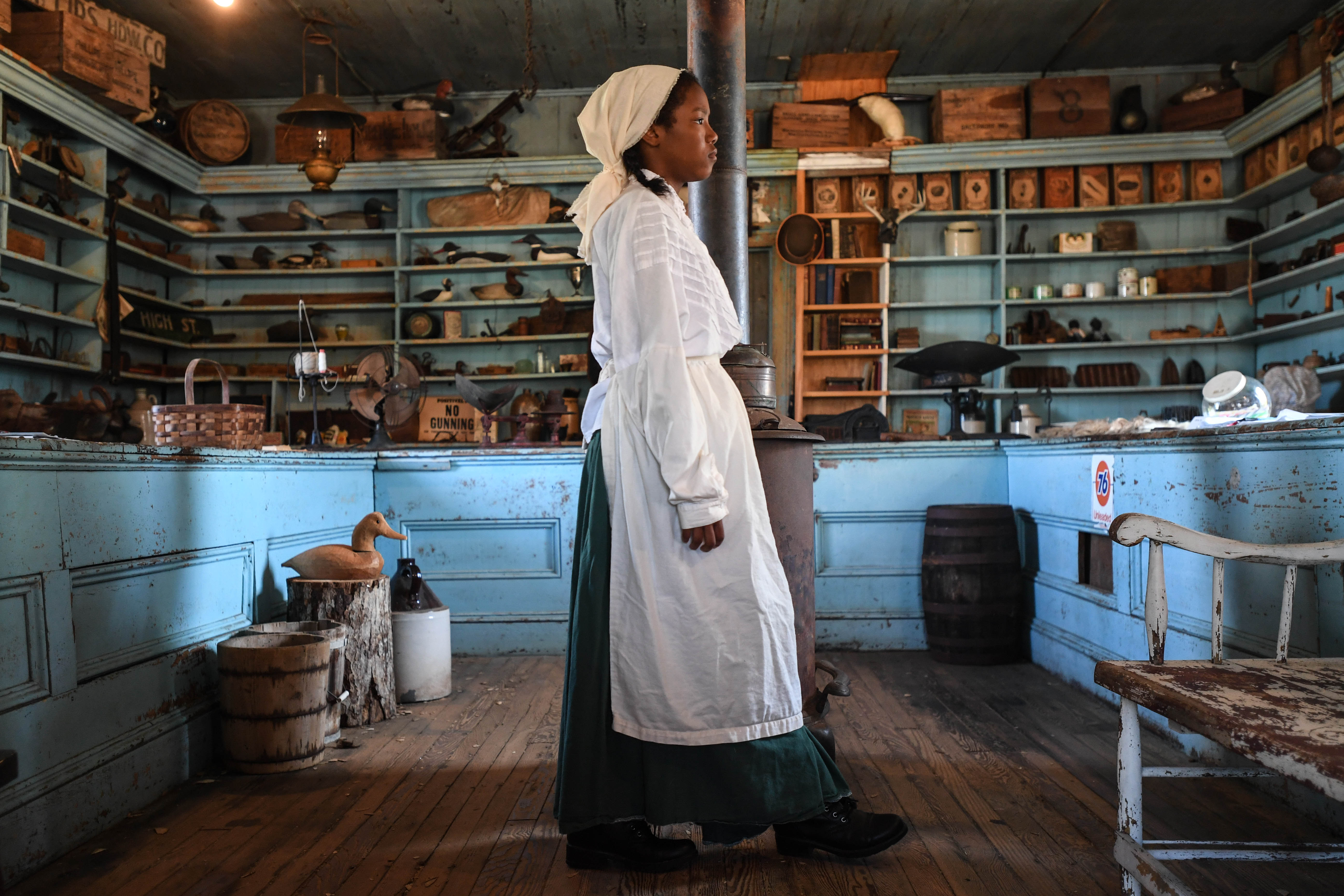 Harriet Tubman, suffered a traumatic brain injury in the local dry-goods store as a child. Now called Bucktown General Store, and still standing today in Cambridge, Maryland, Sydney Rushing, portrays Tubman.