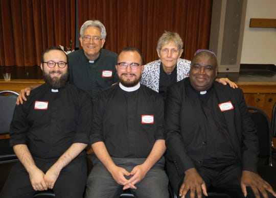 Local religious leaders at installation service: Father Rochell Price (clockwise, from seated far right),  Father Boyle Garrett, Father James Yazell, the Rev. Mark Watson, the Rev. Barbara Jarrell.