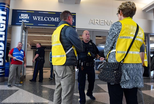 Sioux Falls police officer Eric  Kimball speaks to observers from other city organizations and school districts about the parent-child reunification process created by the Sioux Falls School District as part of an emergency evacuation exercise on Tuesday, Oct. 8, 2019, at the Sioux Falls Arena and Convention Center.
