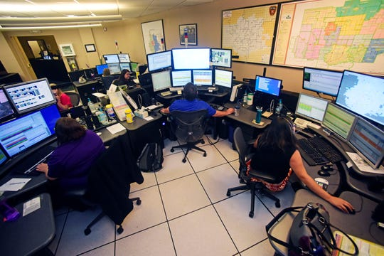 Dispatchers monitor calls from their work station at Metro Communications inside the Minnehaha County Jail in 2017.