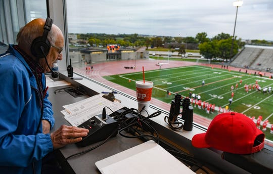 Charlie Childerston announces Lincoln High School's football game against Brandon Valley from the press box on Friday, October 4, at Howard Wood Field in Sioux Falls.