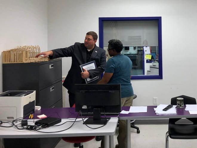 Waynesboro High School technology foundations instructor Wanda Hulse shows student projects to Virginia Superintendent of Public Instruction James Lane on Oct. 8, 2019.