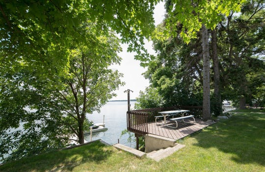 The property offers a waterside deck space built just above the short run of stairs that lead to the dock.