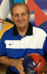 Lew Agius poses for a photo after posting an impressive 728 series.