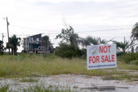 Property owners have found a way to send a message to those looking to buy their properties that they are not for sale. Although it may take some time, and the land looks abandoned right now, they will rebuild.