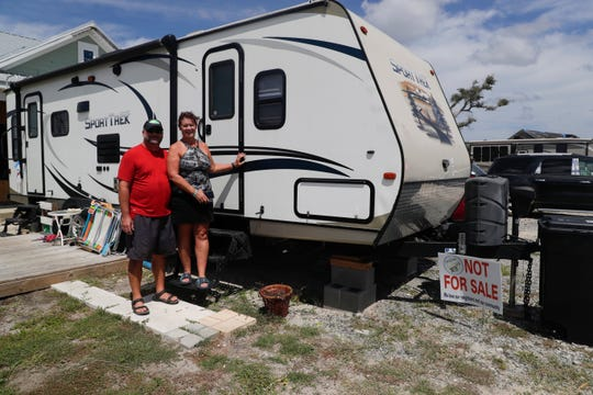 Lisa and Don Seger are living in a camper parked outside of their home while they rebuild.