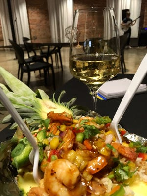 We ordered the shrimp pineapple bowl fromPineappétit,which was parked outside the Bricks & Brass venue on Tennessee, and brought it inside during a comedy night.
