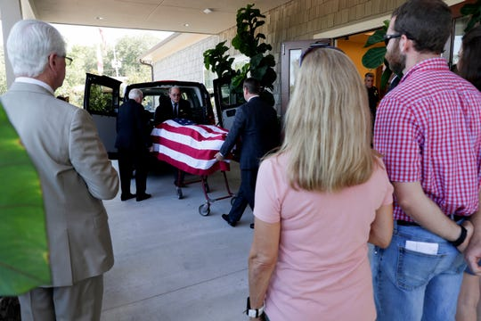 The body of Chris Connell, the director of the Capitol Police and a 28-year veteran of the Tallahassee Police Department, arrives at Bevis Funeral Home from Shands Hospital where he unexpectedly died Friday.