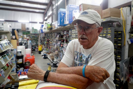 Standing in the back of his family's hardware store, Mayor Al Cathey talks about how proud he is of his community and their resilience after Hurricane Micheal obliterated the town last year.