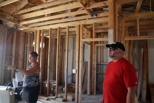Lisa and Don Seger walk through their home, the end unit in a triplex they owned for only six months before it was heavily damaged by Hurricane Michael. They two sold their home in Ohio ten years sooner than they originally planned to move to Mexico Beach full time in order to oversee the rebuild of what was supposed to be their retirement home.