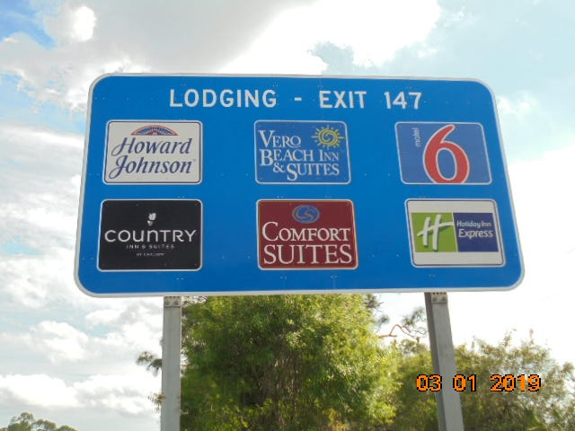 Logo signs found throughout Florida's highway system are mandated by a state law and determined by Florida Logos, Inc. Lodging, restaurants, gas stations and other services within a certain mile radius can apply online to be featured.