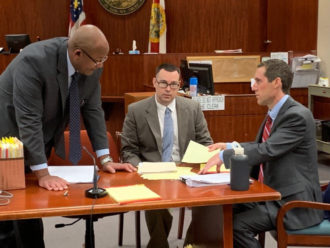 Murder suspect Michael Jones, in middle, assists his court-appointed lawyers, Assistant Public Defender Stanley Glenn, left, and Assistant Public Defender Shane Manship during jury selection for his first-degree murder trial on Oct. 8, 2019 at the Indian River County Courthouse.