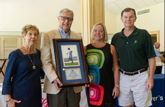 Richard Sooy (second from left) stands with his family after receiving the Steven C. Owen Award on Saturday, Oct. 5, 2019. The award recognizes those who demonstrate courage and perseverance during challenging times in life while giving back to the game of golf.