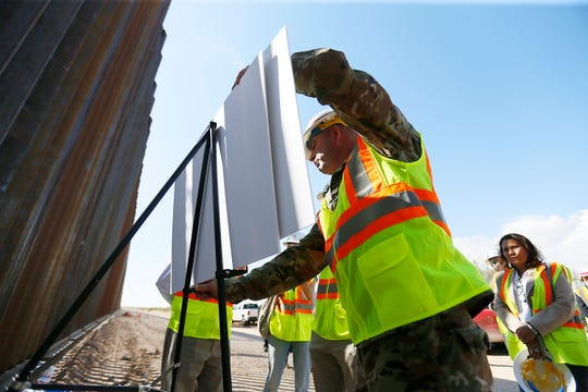 Representative Adam Smith, chairman of the House Armed Services Committee, and Representative Veronica Escobar, tour the construction site of a new border fence being built in rural Southern New Mexico between Santa Teresa and Columbus, N.M., South of Highway 9 Tuesday, Oct. 8, in N.M.