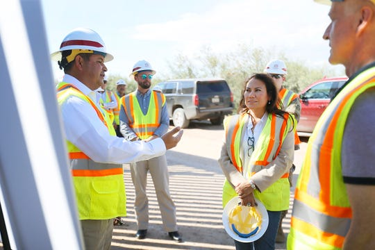 U.S. Rep. Veronica Escobar, center, and U.S. Rep. Adam Smith, far right, chairman of the House Armed Services Committee, are given details about border fence construction by U.S. Army Corps of Engineers regional business director John Moreno, far left, on Tuesday, Oct. 8, 2019, in New Mexico. The border fence is being built in rural Southern New Mexico between Santa Teresa and Columbus, south of Highway 9.