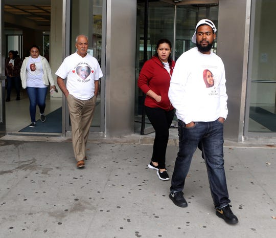 Junior Casado, right, the brother of Diana Casado, along with other family members, leaves the Westchester County Courthouse in White Plains Oct. 8, 2019 after attending the arraignment of Luis Alturet-Rivera, who is charged with second-degree murder in the Jan. 22, 2017 death of the Yonkers woman.