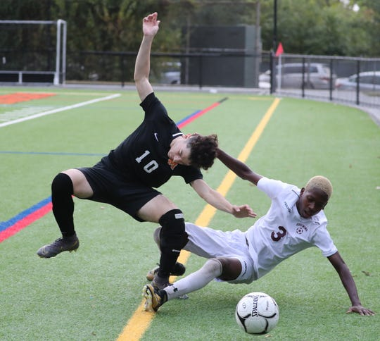 Mamaroneck's Milton Manicias-Magana is taken down by Ossining's Kevon Evans during their game at Mamaroneck Oct. 7, 2019. Ossining won  2-1 in OT.