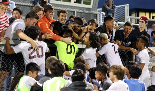 Ossining players celebrate with their fans after winning 2-1 in OT at Mamaroneck Oct. 7, 2019.