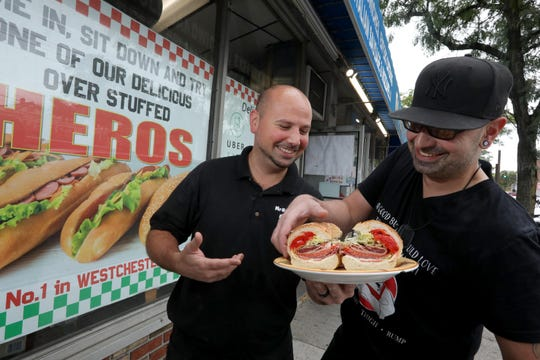 Anthony and Ronnie Paldino, who's family owns Mr. Kold Kuts in Yonkers, with one of their sandwiches Oct. 8, 2019. In Yonkers and many parts of Westchester County, the sandwich is commonly referred to as a wedge, but throughout the Lower Hudson Valley, they are also known as heroes, and less commonly as subs.