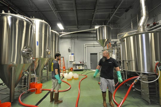 "2SP Brewing head brewer Bob Barrar (right) and head cellarman Andrew ""Ruby"" Rubenstein make beer in 2SP's production brewery in Aston, Pennsylvania."