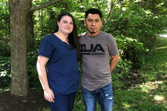 In a photo taken June 21, 2019, Alyse Sanchez and her husband, Elmer Sanchez, pose for The Associated Press in Sandy Spring, Md. The Sanchezes and five other couples have filed a lawsuit in U.S. District Court in Maryland arguing U.S. immigration authorities are luring couples to marriage interviews only to detain the immigrant spouses. (AP Photo/Regina Garcia Cano)