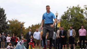 Local male celebrities walk, or in some cases stumble, in women's shoes to raise awareness for domestic violence.