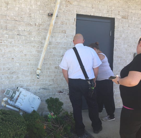 Steak and Shake was evacuated Tuesday after a motorist struck the building, damaging a gas meter.