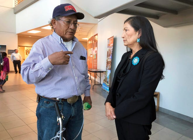Leslie Begay, left, speaks with U.S. Rep. Deb Haaland, D-New Mexico, in a hallway outside a congressional field hearing in Albuquerque, N.M., highlighting the atomic age's impact on Native American communities on Monday, Oct. 7, 2019. Begay, a former uranium miner on the Navajo Nation with lung problems, says there are lingering injustices and health problems on his reservation decades after mines closed.