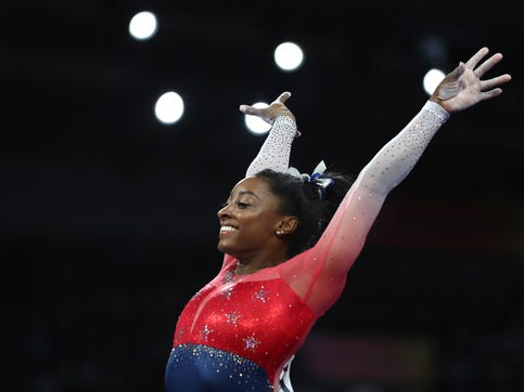 Simone Biles of the United States performs on the vault during the women's team final at the Gymnastics World Championships in Stuttgart, Germany, on Oct. 8, 2019. (AP Photo/Matthias Schrader)