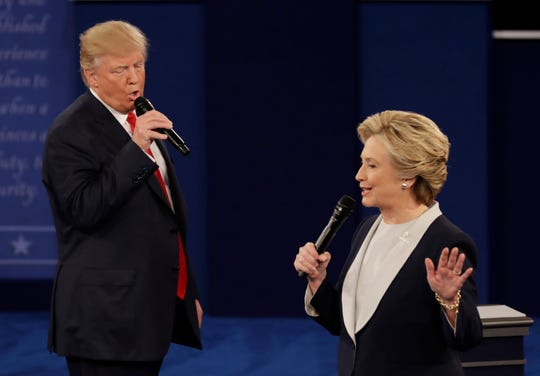 President Donald Trump and Hillary Clinton debate in 2016. Trump joked about a rematch in 2020.