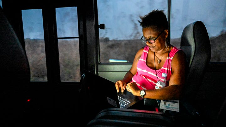 7/31/19 1:14:48 PM -- Luanda, Angola -- Behind the scenes of the 1619 Project. Deb Berry working on the bus. -- Photo by Kelley French, USA TODAY ORG XMIT: JH 138203 1619 Project_ Wa 8/2/2019 [Via MerlinFTP Drop]