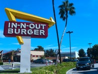 A driver pulls into the drive-thru lane at an In-N-Out Burger restaurant in Alhambra, California.