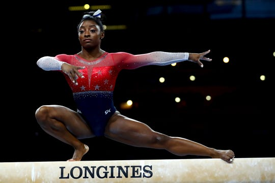 Simone Biles of the U.S. performs on the balance beam during women's team final at the Gymnastics World Championships in Stuttgart, Germany,
