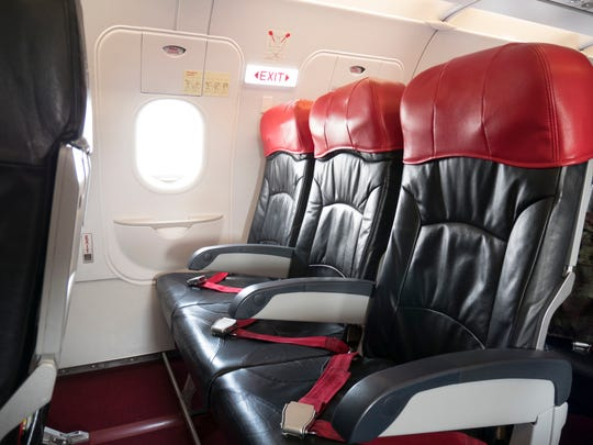 You may be tempted to book a seat in an exit row but be aware those armrests can't be lifted.