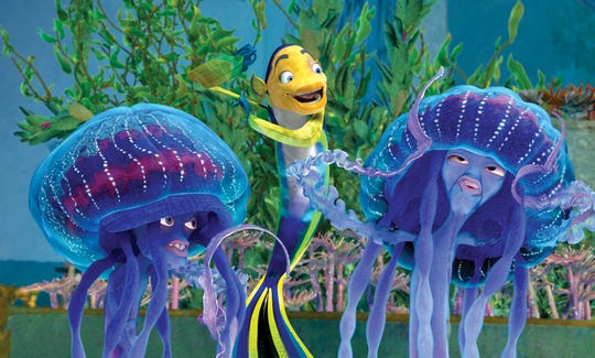 (center) Oscar (WILL SMITH), Ernie and Bernie (ZIGGY MARLEY, left, and DOUG E. DOUG) in a scene from the motion picture Shark Tale. --- DATE TAKEN: Rec'd 09/04  No Byline   Dreamworks Animation        HO      - handout   ORG XMIT: ZX26526