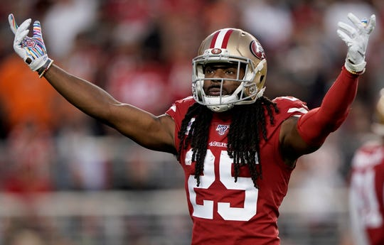 Richard Sherman encourages the crowd before a play during Monday night's win over the Browns.