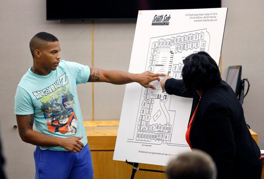 In this Tuesday, Sept. 24, 2019, photo, victim Botham Jean's neighbor Joshua Brown, left, answers questions from Assistant District Attorney LaQuita Long, right, while pointing to a map of the South Side Flats where he lives, while testifying during the murder trial of former Dallas Police Officer Amber Guyger, in Dallas. Authorities say that Brown was killed in a shooting Friday, Oct. 4.