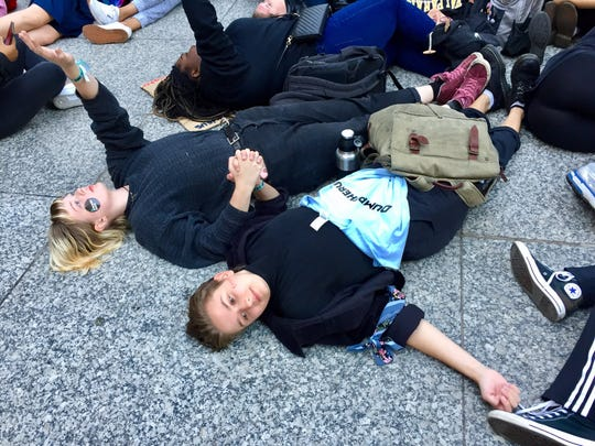 """Students with Illinois Youth Climate Strike stage a """"die-in"""" across from City Hall in Chicago, Illinois on Oct. 7, 2019."""