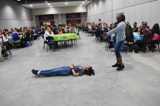 Rapides Academy students Jakayla Moore and Lily Murphy perform a scene about a mother mourning her daughter who died from tobacco use during a breakout session at the Rapides Foundation's ninth annual Youth Summit on Healthy Behaviors held Wednesday, Oct. 9, 2019. About 600 students and teachers from seven Central Louisiana school districts attended. The Youth Summit, held at the Randolph Riverfront Center, is a one-day event for students to learn how to become advocates for healthy choices and policy change in their schools and communities. The theme of the event was #MoveMore #EatWell #LiveClean.