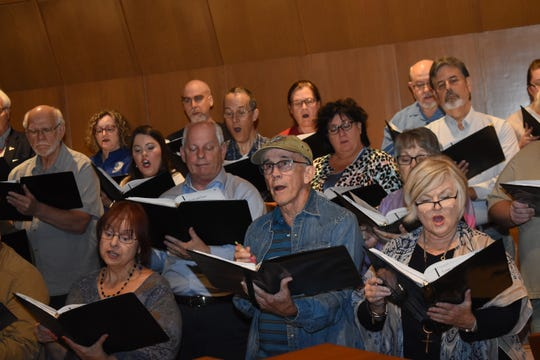 "Members of the Red River Chorale rehearse for their opening season concert, ""Celebrating America,"" set for 7:30 p.m. at First United Methodist Church, Alexandria."