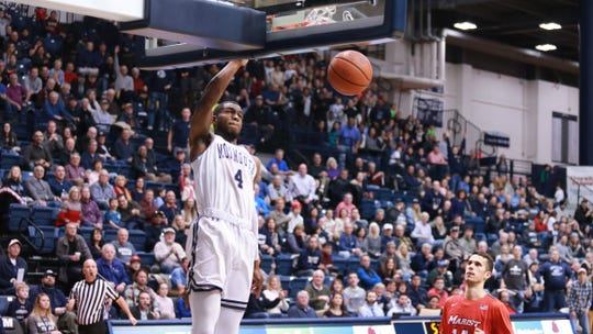 Monmouth forward Mustapha Traore dunks against Marist in a 2019 game at OceanFirst Bank Center in West Long Branch.