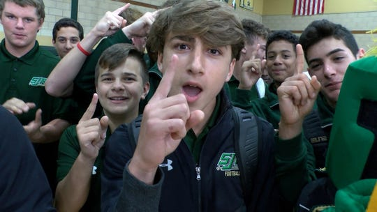 St. Joseph's High School students get fired up during a taping of the Red Zone Road Show in Montvale Tuesday, October 8, 2019.  They face Bergen Catholic in the Red Zone Game of the Week Saturday.