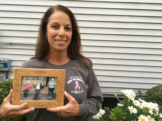 Cathy Commesso Juska holds a photo of her mother Ellen Commesso and her two aunts. All battled breast cancer.