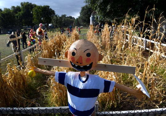 "Students from the Abilene Independent School District set up their scarecrows, many of them storybook characters such as David from the ""No, David!"" children's books by author and CALF guest David Shannon. The students were installing them at the Taylor County History Center grounds Wednesday."
